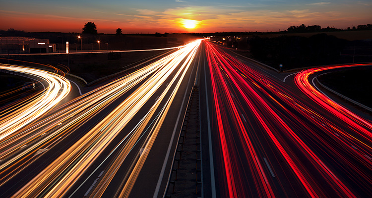 Time lapse image of a busy highway at sunset